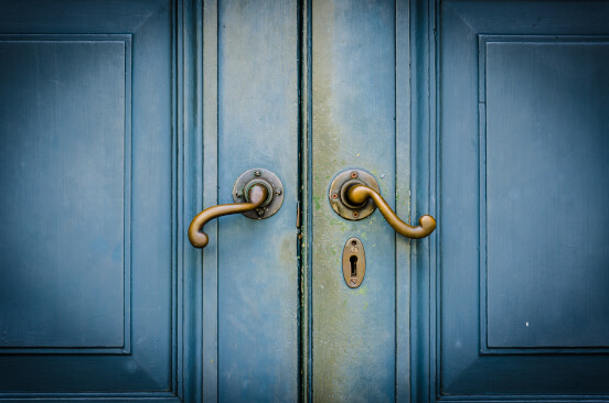 Blue vintage door with golden door handle