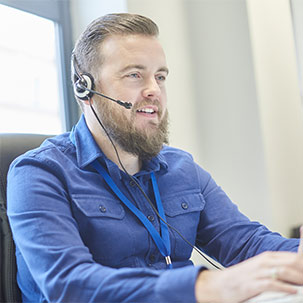 A man in a call using a headset