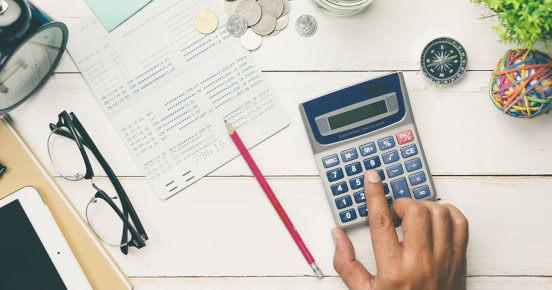 Glasses, pencil and calculator