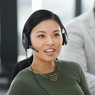 A woman in a call using a headset