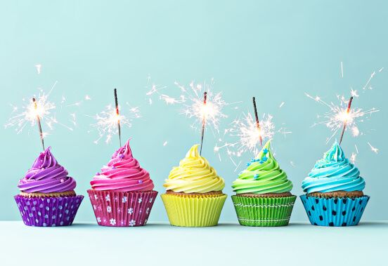 Colorful muffins with sparklers