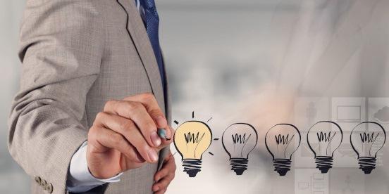 A man drawing light bulbs